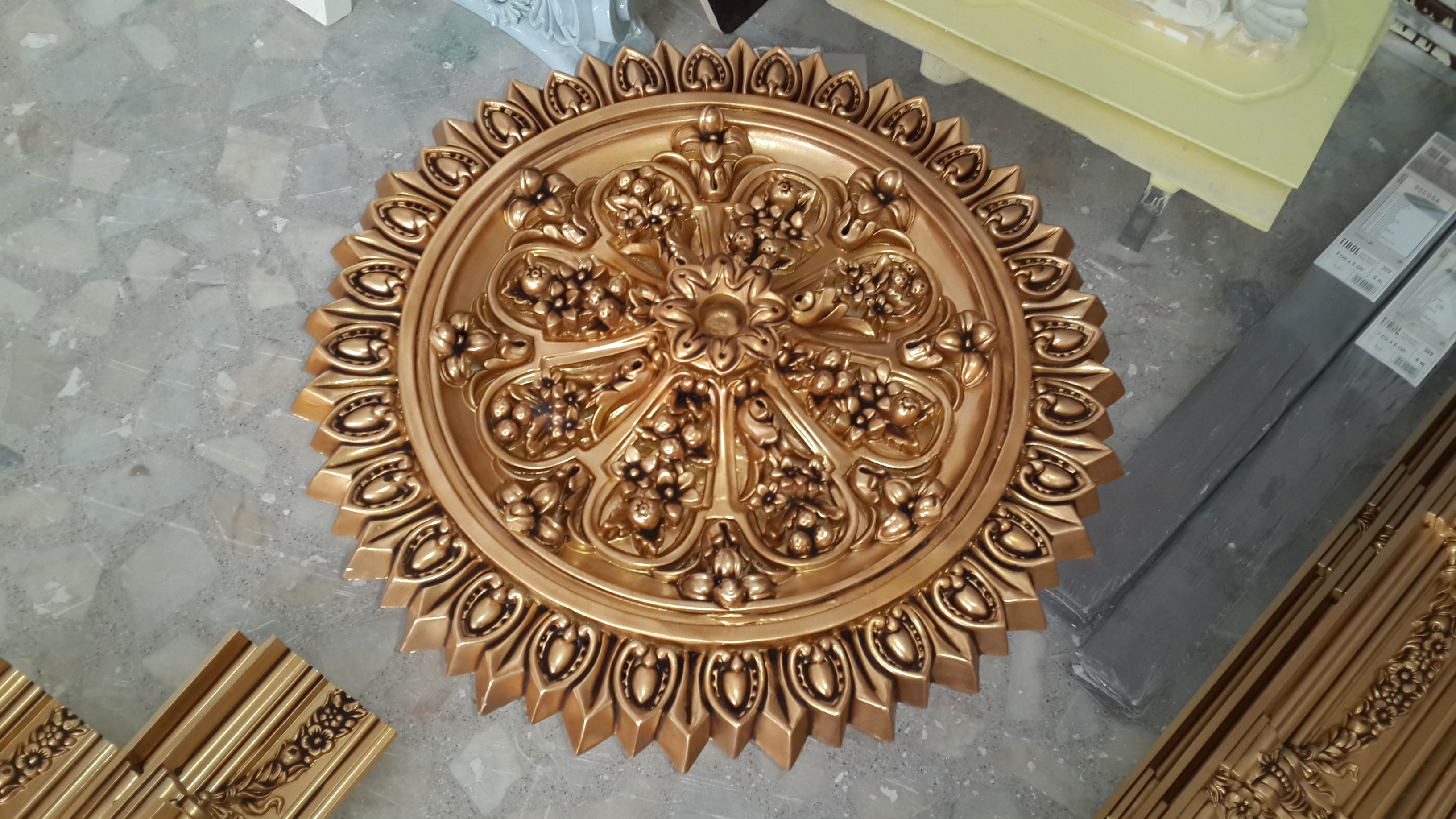 We are the manufacture of polyurethane decorative ornament ceiling rose moulding with carved gold leaf.Polyurethane rosette models are equivalent of styrofoam gold gilded,silver and gold leaf ceiling rose ornament models.